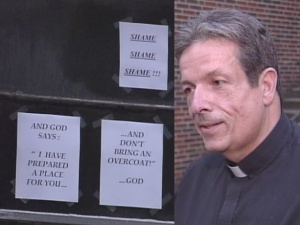 The Rev. David Dzermejko posted these signs on a church building in Charleroi after someone vandalized it in 2007.