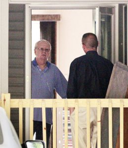 The Rev. Terence McAlinden, left, declined to comment when a reporter knocked on his door. McAlinden has acknowledged sleeping nude with teenage boys.Ed Murray/The Star-Ledger