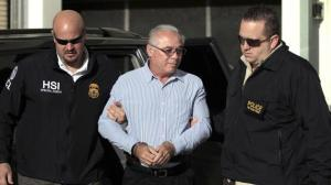 Pedophile Catholic priest Israel Berrios is escorted by agents from the FBI, R, and Homeland Security, L, after they arrested him in Guaynabo, May 13, 2014