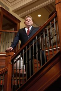 Patrick Wall on the stairs of Jeff Anderson and Associates' office in St. Paul