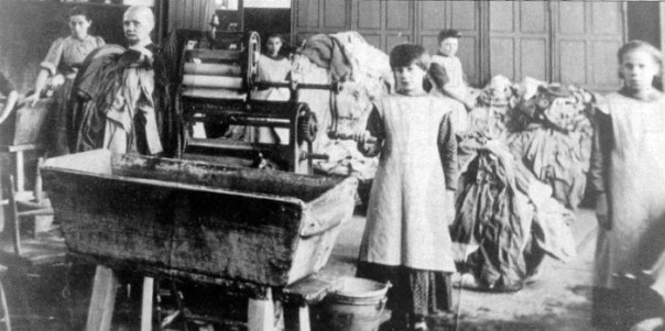 Girls and women working in Catholic Church's Magdalene Laundry in Ireland in the early 20th century. Public domain photo in the US, via Wikipedia. (PD-US-1923-ABROAD)