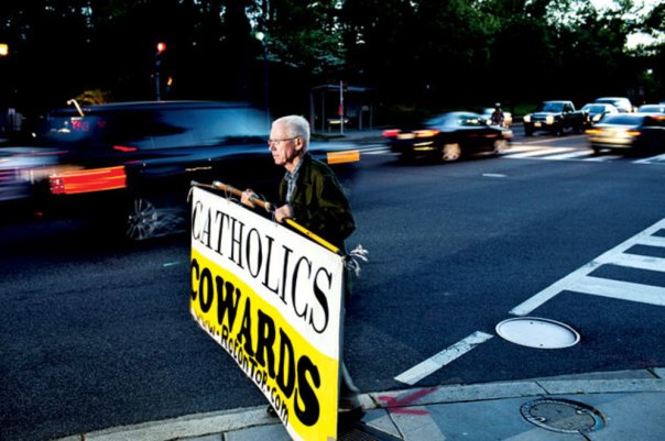 "Wojnowski is a fixture on Massachusetts Avenue during evening rush hour, almost never taking a day off. ""There are not breaks in a war,"" he says. Photograph by Melissa Golden."