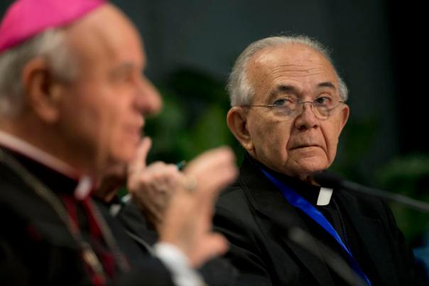 FILE - In this Feb. 4, 2015, file photo, monsignor Jesus Delgado, right, listens to Archbishop Vincenzo Paglia, president of the Pontifical Council for Families, during a press conference, at the Vatican. El Salvador's Roman Catholic Church announced Thursday, Nov. 25, that it has suspended the well-known priest, saying he acknowledged sexually abusing a young girl. (AP Photo/Andrew Medichini, File)