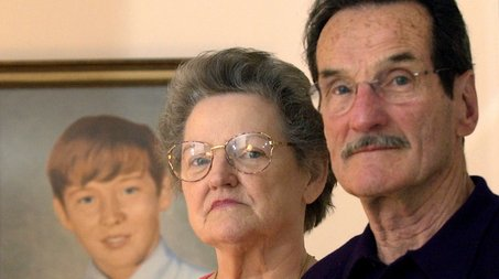 File photo / The RepublicanCarl and Bernice Croteau stand in front of a portrait of their murdered son, Danny, in their Springfield home in this 2003 photo.