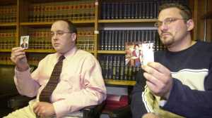 In 2003, Brian Gergely, right, and Kevin Hoover show old photographs of themselves during a news conference in Altoona, Pa. They said the pictures were taken during the time they allege a Roman Catholic priest sexually abused them while they were altar boys. The men, along with three others, sued the Altoona-Johnstown diocese, about 80 miles east of Pittsburgh, Bishop Joseph Adamec, and former Bishop Joseph Hogan, claiming the church should have known about the abuse and was negligent. (AP Photo/Keith Srakocic)