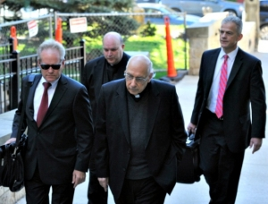 In this April 14 photo, lawyers lead Franciscans Franciscan Fathers Giles Schinelli (front) and Anthony Criscitelli to their hearing at the Blair County courthouse in Hollidaysburg, Pa. The men are charged with allowing a suspected sexual predator to teach at a Pennsylvania high school and hold other jobs where he molested more than 100 children. – Todd Berkey/The Tribune-Democrat via AP, File